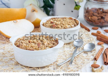 Baked oatmeal with nuts, almond milk, honey, spices and asian pear, horizontal