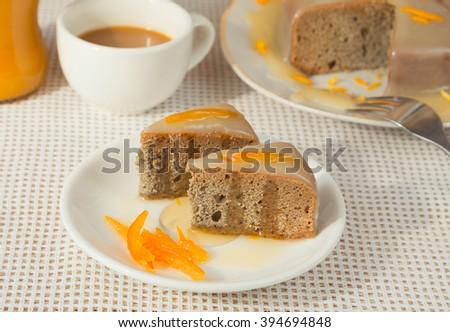Baked orange cake with vanilla sauce - stock photo