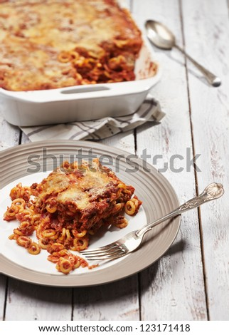 baked pasta on withe table - stock photo