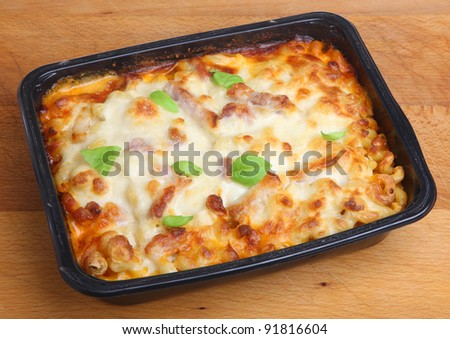 Baked pasta ready meal with spiral pasta, chicken, bacon and cheese.