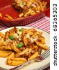Baked pasta with bolognese sauce and cheese. - stock photo