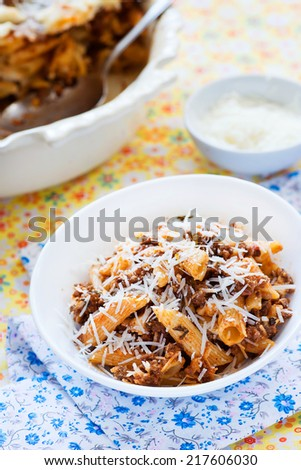Baked pasta with meat tomato sauce and cheese, selective focus - stock photo
