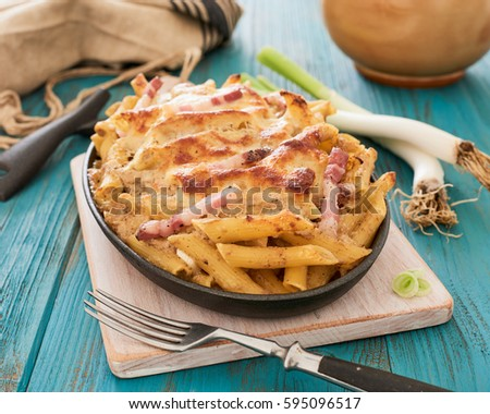 Baked pasta with mushroom sauce and bacon
