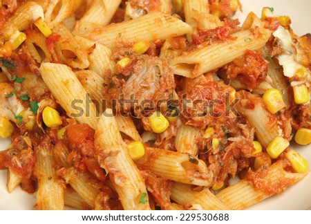 Baked pasta with tuna and cheese - stock photo