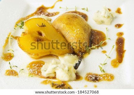 baked pear with caramel and gorgonzola cheese - stock photo