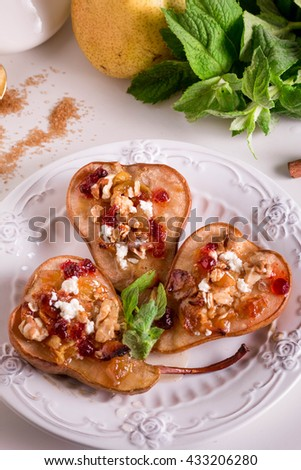 Baked Pears with Walnuts, Cinnamon, Nutmeg, Honey, Brown Sugar, Oat Crumble and Goat Cheese. Dessert Recipe - stock photo