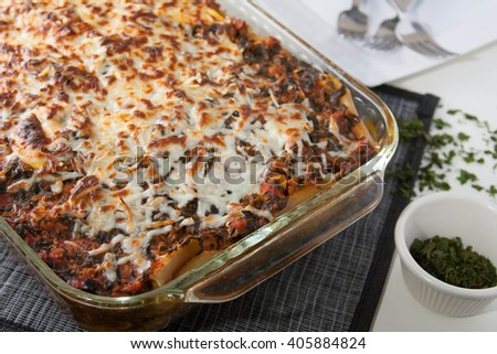 Baked penne pasta with sausage and spinach - stock photo