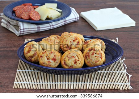 Baked Pepperoni and cheese swirled appetizers. - stock photo
