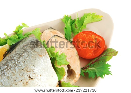 baked pink salmon served on plate with salad - stock photo
