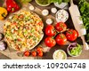 Baked pizza and ingredients - stock photo