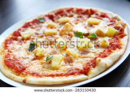 baked pizza hawaii - stock photo