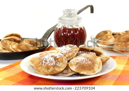baked Poffertjes on a white background - stock photo