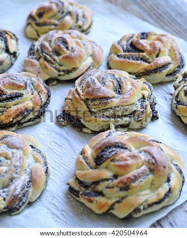 Baked poppy seed buns closeup