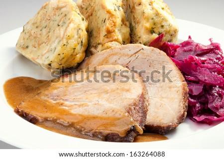 Baked pork chop with dumplings and sauerkraut - stock photo