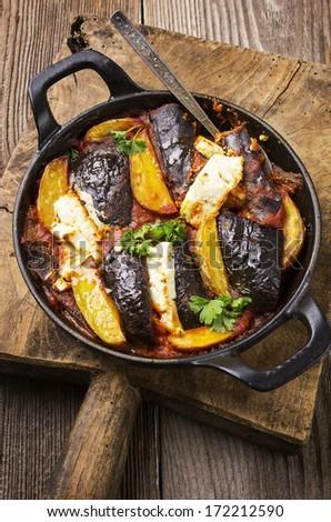 baked potato and eggplant with feta - stock photo