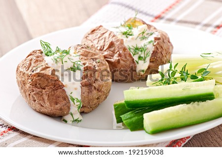 Baked potato filled with sour cream - stock photo