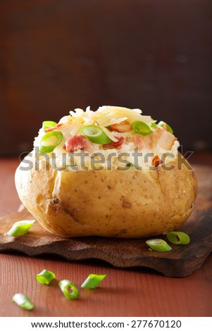 baked potato in jacket with bacon and cheese - stock photo