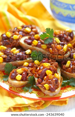 Baked Potato Skins with Mexican Chili Con Carne - stock photo