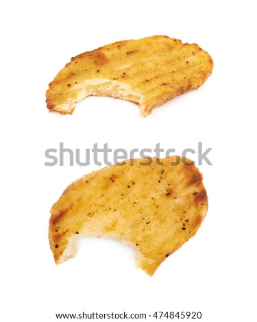 Baked potato slice with a single bite taken of it, composition isolated over the white background, set of two different foreshortenings