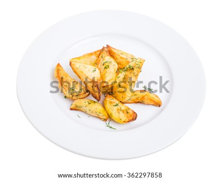 Baked potato wedges with minced dill. Isolated on a white background. - stock photo
