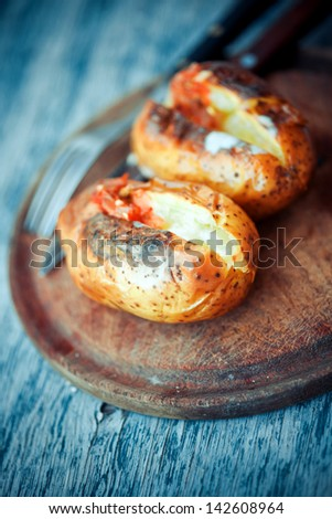 Baked Potato with cheese and hot salsa - stock photo