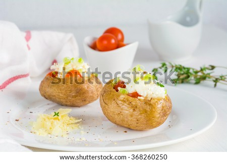 Baked potato with cheese, sour cream and red caviar  - stock photo