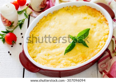 Baked potato with chicken, mushrooms and cheese - stock photo