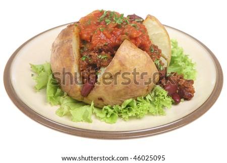 Baked potato with chilli and tomato salsa. - stock photo