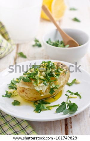 Baked potato with gremolata sauce