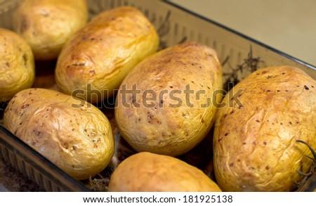 Baked potatoes. - stock photo