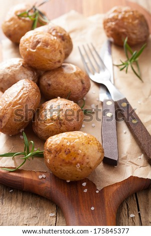 baked potatoes on chopping board