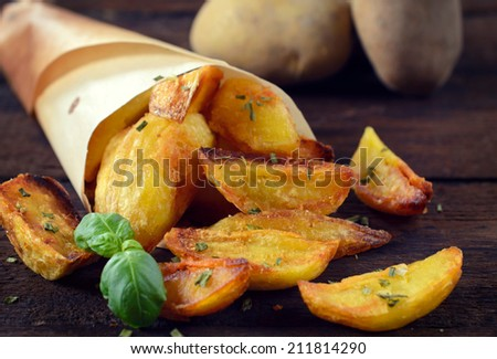Baked potatoes on the wooden background.selective focus in the middle  - stock photo