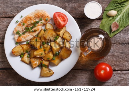 Baked potatoes with chicken steak and vegetables. top view - stock photo