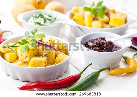 Baked potatoes with chutney and sour cream - stock photo