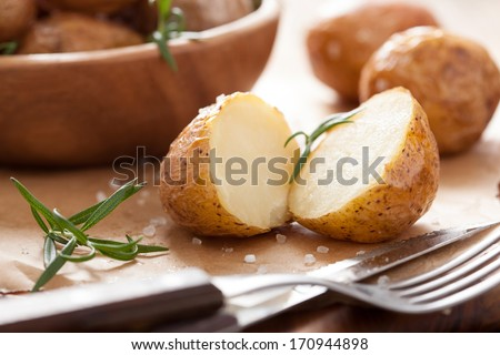 baked potatoes with rosemary  - stock photo