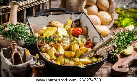 Baked potatoes with rosemary and garlic - stock photo