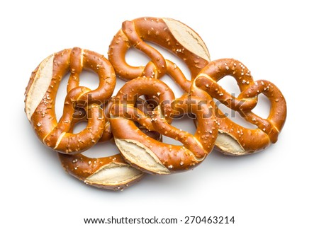 baked pretzels on white background - stock photo
