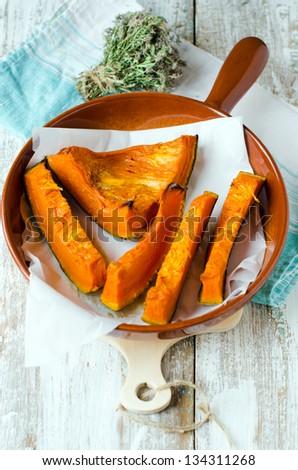 Baked pumpkin. Selective focus - stock photo