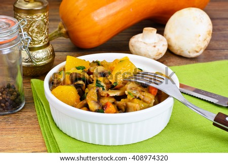 Baked Pumpkin with Mushrooms and Vegetables. Vegetarian Food. Studio Photo