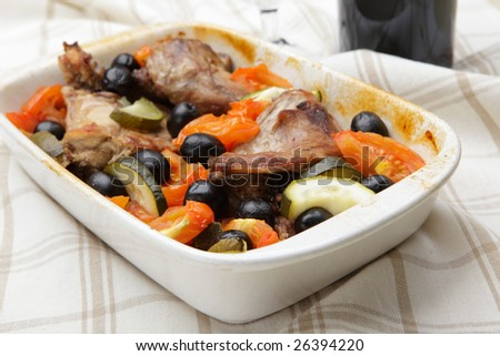 Baked rabbit with vegetables in rectangular ceramic bowl