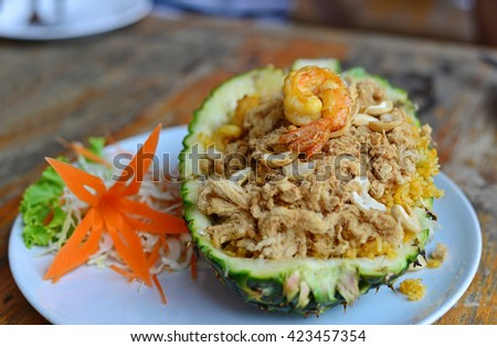 Baked rice with pineapple and shrimp served in a pineapple. (Selective Focus)