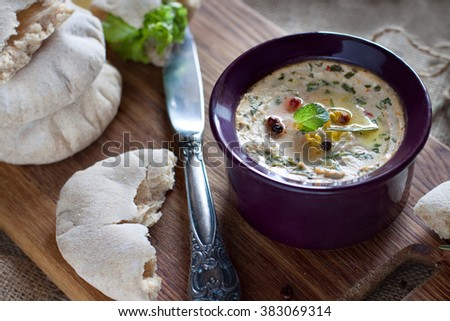 Baked ricotta cheese dip with herbs and homemade pitas - stock photo