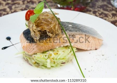 Baked salmon fillet with vegetables in a restaurant - stock photo