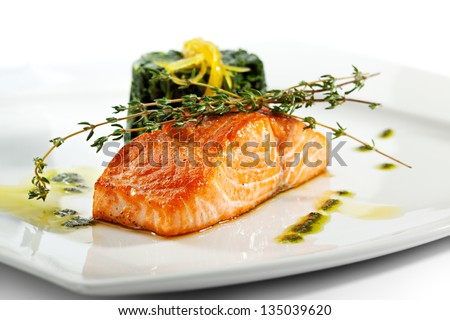 Baked Salmon Steak with Spinach and Lemon Slice - stock photo