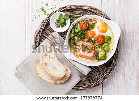 Baked salmon with eggs for breakfast
