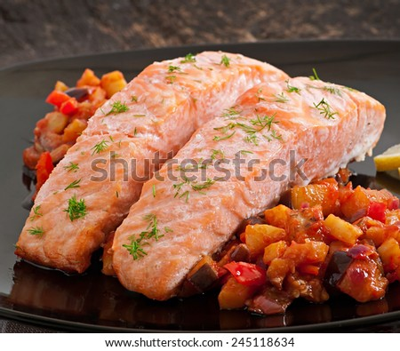 Baked salmon with vegetables ratatouille - stock photo