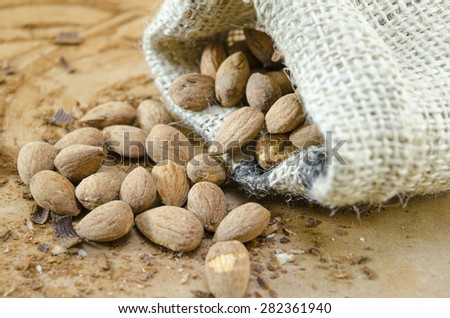 Baked salty almonds falling out of a vintage bag