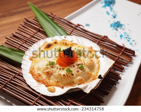 Baked Scallops with Cheese recipe - stock photo