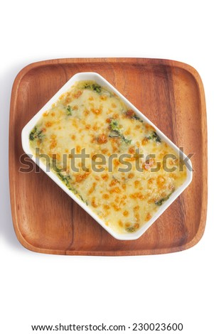 Baked spinach combine with cream, egg and mozzarella cheese, isolated on white. - stock photo