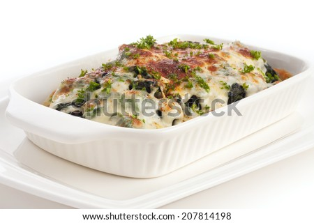 baked spinach with cheese isolated on white. - stock photo